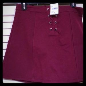 Burgundy shirt skirt with lacing detail in front